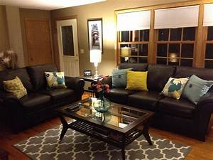 Brown leather sofa and colorful pillows funky living room for Stratford home pillows living room furniture