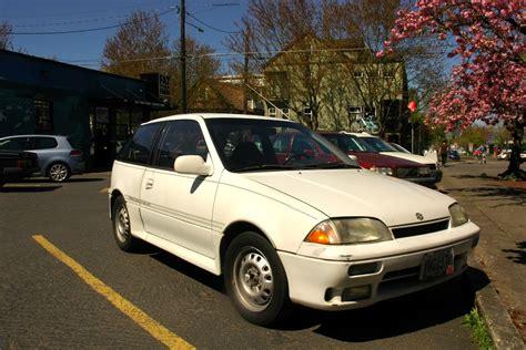 parked cars  suzuki swift gti