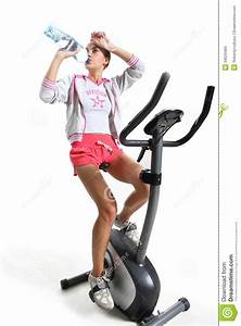 Exercising On Exercise Bike Royalty Free Stock Images
