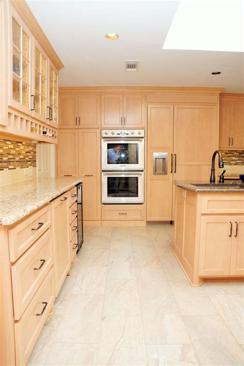 light maple cabinets stainless steel appliances tan