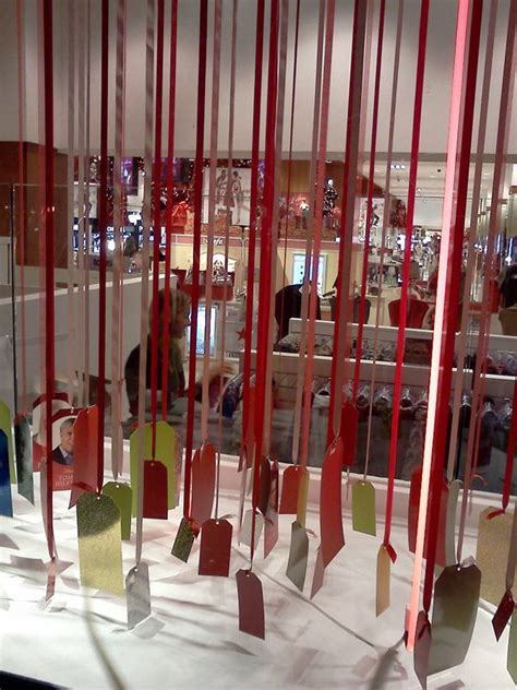 holiday windows inspire holiday display  harriete