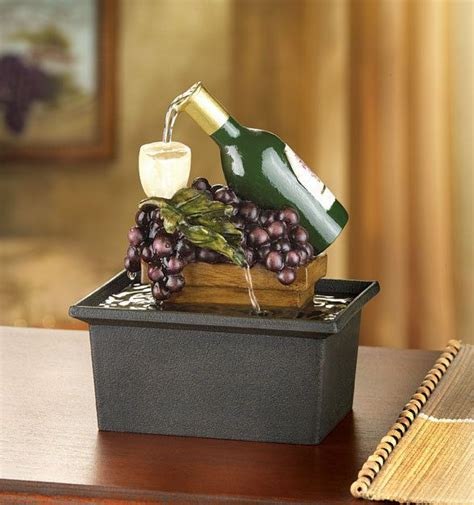 fountain wine bottle glasses grapes grapevine table top