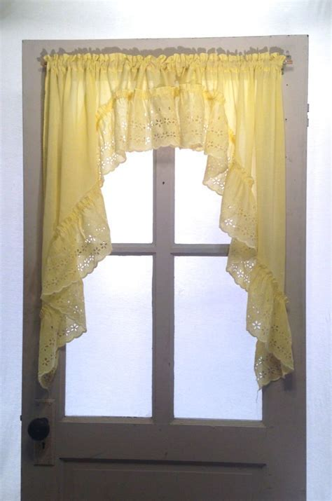 Soft yellow cafe curtain swag; white yellow eyelet ruffle