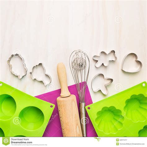 Bake Tools With Cake Mould And On White Wooden Background