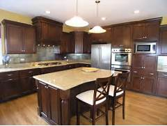 Kitchen Cabinets And Counters Darker Cabinets Stand Out Against The Light Color Of The Hardwood