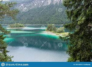 View, Through, The, Trees, To, The, Eibsee, Mountain, Lake, In, The, Bavarian, Alps, Germany, Stock, Photo