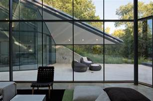 paneled glass walls of pit house outdoor interior design ideas