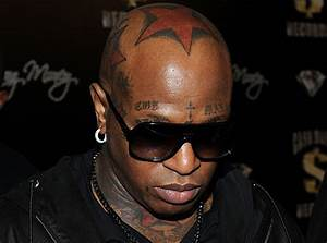 10 Rappers With Surprising Face Tattoos