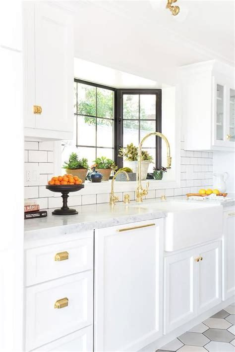 gold kitchen cabinet hardware white and gold kitchen features white cabinets adorned