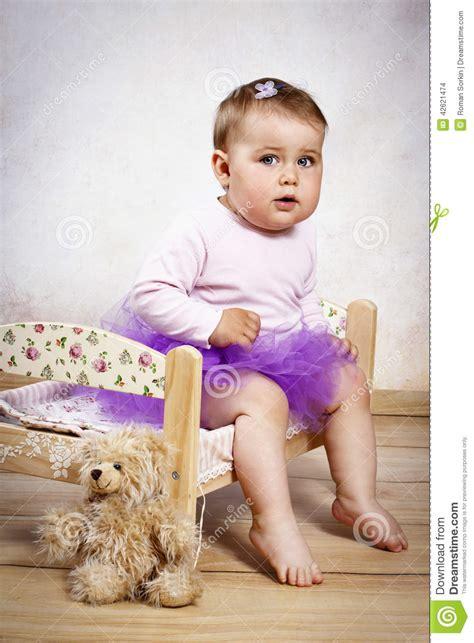 baby girl  tutu skirt sitting   small bed