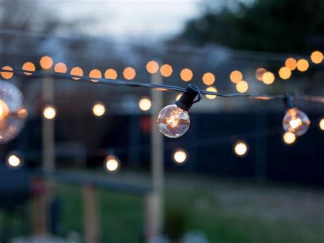 hanging globe lights outdoors how to hang outdoor string lights from diy posts hgtv