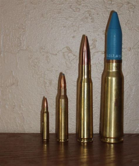 Lapua Vs 50 Bmg by From Left To Right 5 56 338 Lapua 50bmg 20mm Vulcan