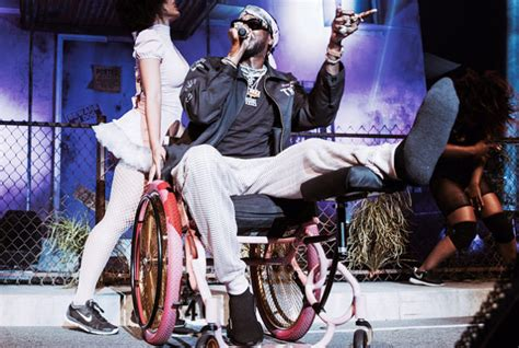 Whose Chair Is That by 2 Chainz Takes Stage In Pink Wheelchair After Breaking Leg