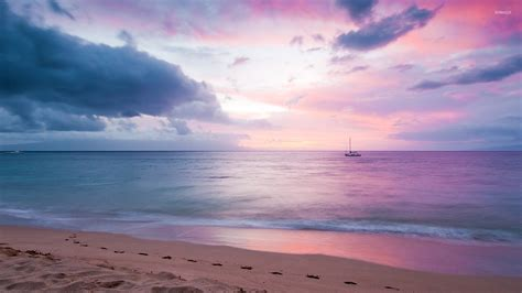 Small Boat On The Ocean by Small Boat In The Ocean At Sunset Wallpaper Beach