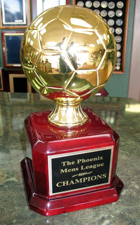 tall trophy  gold plated soccer ball  piano