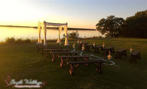 Waterfront wedding with bamboo canopy and rustic wooden