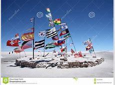 Flags In A Salt Desert Of Salar De Uyuni Stock Photo