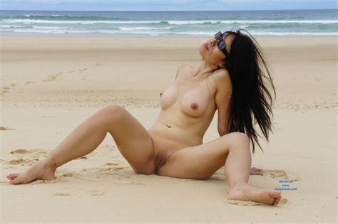 Naked Wife Playing On The Beach While Wearing Her Shade As She Teases Us January