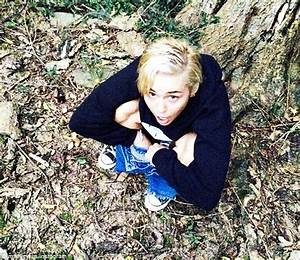 miley cyrus pops a squat in the forest and posts picture With miley cyrus line in the bathroom