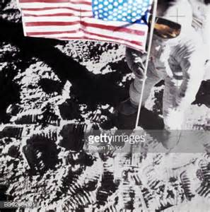 Astronaut On Moon Holding Us Flag Elevated View Stock ...