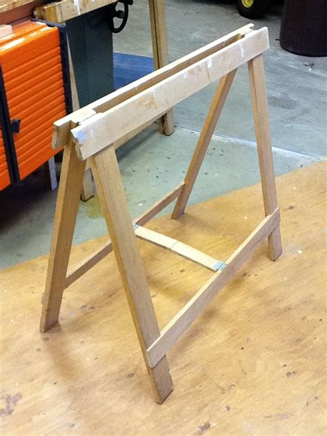 folding sawhorse stows  finewoodworking