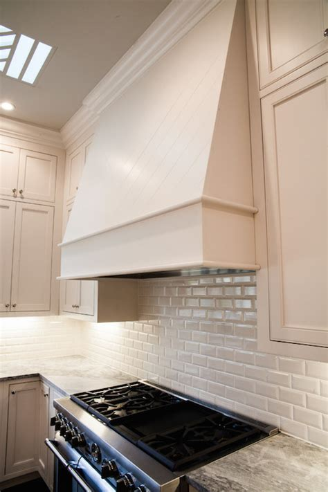 gray kitchen hood  gray spice cabinets transitional kitchen