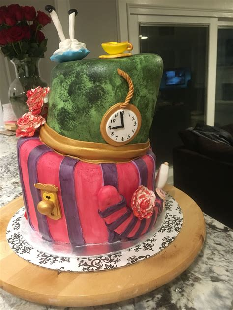 Maybe you would like to learn more about one of these? Alice in Wonderland topsy turvy cake   Cupcake cakes ...