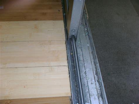 patio door repair how to repair or replace sliding glass door rollers diy