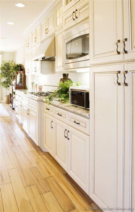 kitchen flooring  white cabinets antique white