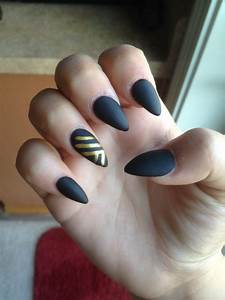 Acrylic nails with matte black and gold. Only cost me $30 ...