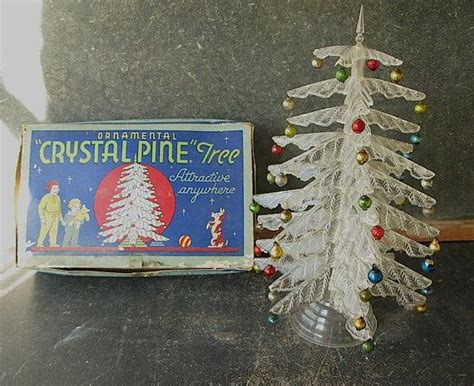 table top christmas tree in pleiglass with falling snow vintage clear plastic tabletop tree peerless by passedby vintage and antique