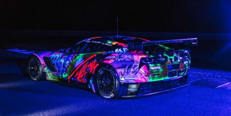 graffiti covered corvette le mans race car   cool
