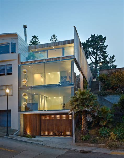 Garage House by Garage And 3rd Floor Deck Connects Glass Home To Slope