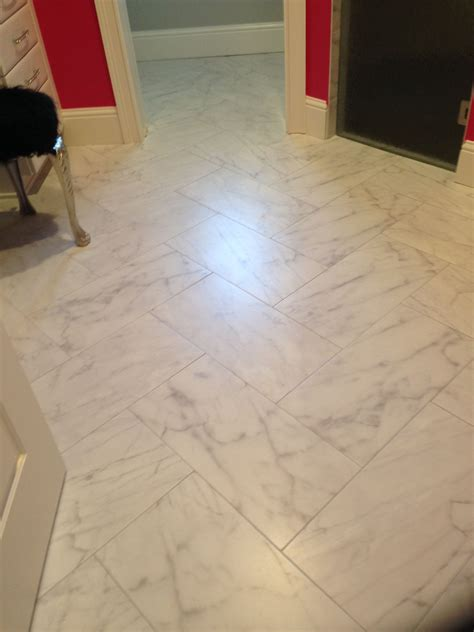 carrara  porcelain tile  herringbone pattern