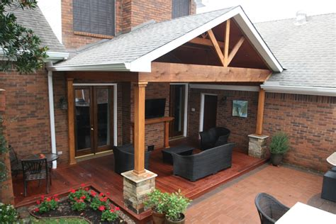 half covered patio nice hardwood deck and gable roof patio cover with ledgestone half columns and tongue and groove