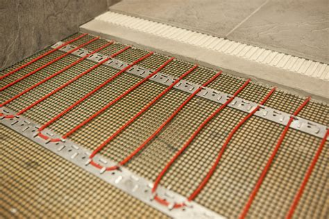 replacing baseboard heaters with forced air electric heat mats for concrete underfloor heating