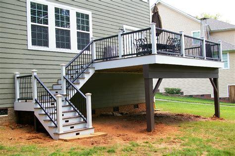 deck with decorative iron railing deckscapes