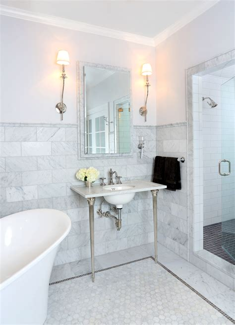 bathroom marble tile this bathroom is the ultimate spa like retreat with carrera marble tile a french free standing