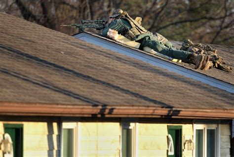 Man Barricades Himself Inside Troy, Ill., Home, Police Say Roofing Contractors Grand Rapids Mi Red Roof Inn Las Vegas Resort Fee Des Moines Iowa Mighty Metal Memphis Beyers Bloomington Indiana Pipe Boot Installation Of Corrugated Installing Steel Valleys