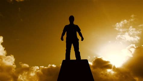 Beautiful Warm Cloudscape With Man Silhouetted Standing