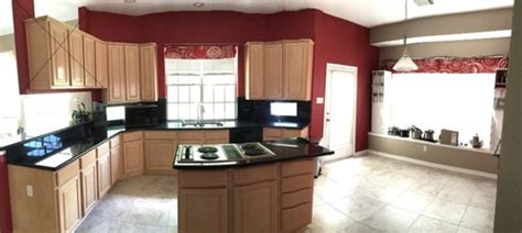 affordable kitchen design help with another two tone kitchen white uppers stained 1172
