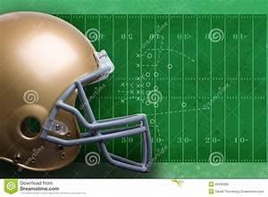 Gold Football Helmet Against Field Diagram Stock Photo