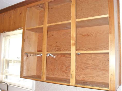 painting knotty pine kitchen cabinets the remodeled diy painting knotty pine cabinets