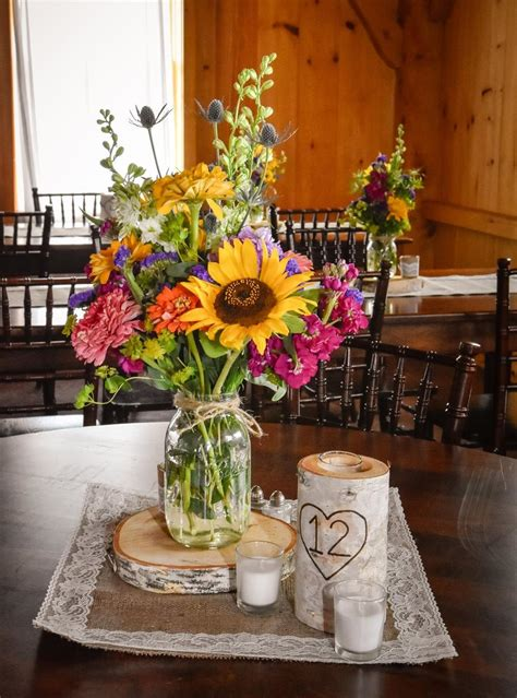 love  country wildflower centerpieces featuring
