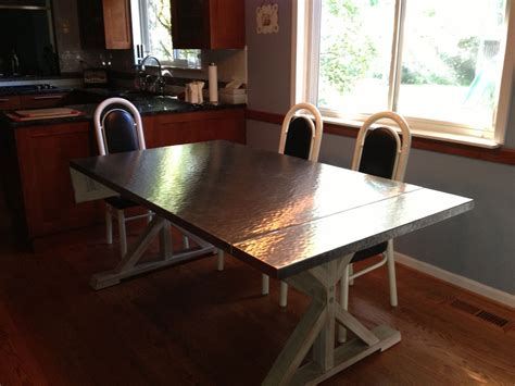 handmade custom hammered stainless steel dining table