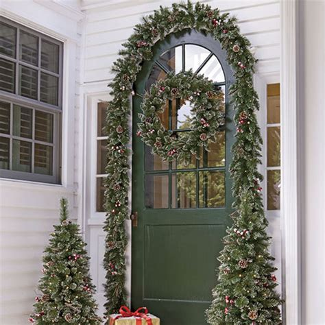 garland around front door and festive d 233 cor 3736