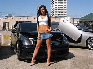women in short skirt driving car