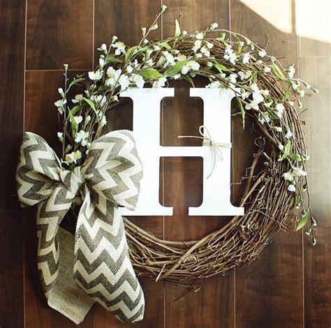 monogrammed grapevine wreath  white cherry blossom details