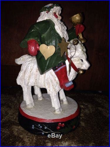 house  hatten santa riding  billy goat  christmas