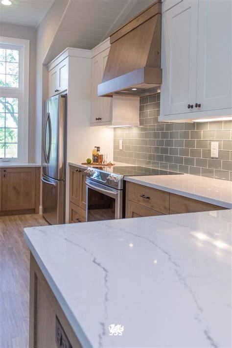white kitchen cabinets white countertops our ella quartz countertop is a soothing complement to a 1809